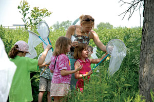 PHOTO: children catching insects in a discovery program