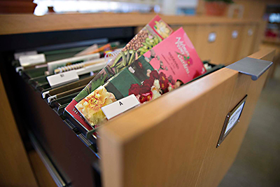 PHOTO: Library files full of seed catalogs from specialty nurseries.