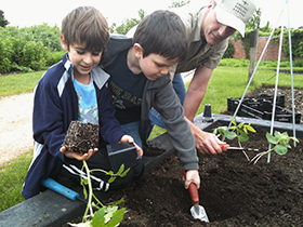 PHOTO: Planting with kids.