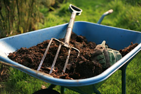 PHOTO: Use a wheelbarrow to mix new soil into your garden beds