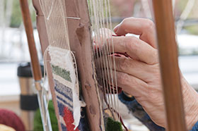 PHOTO: Loom Weaving class.