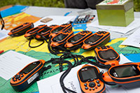 PHOTO: A pile of GPS units waits for kids to use on a treasure hunt.