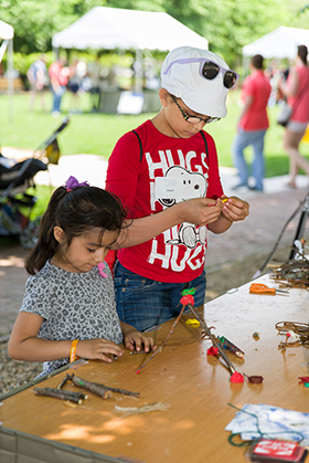 PHOTO: Kids build things with sticks on the Esplanade.