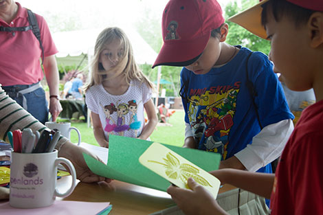 PHOTO: Kids making prints at the Openlands booth on the Esplanade.