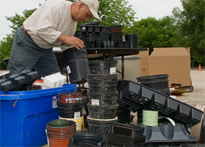 PHOTO: Garden employee sorting plant containers for recycling