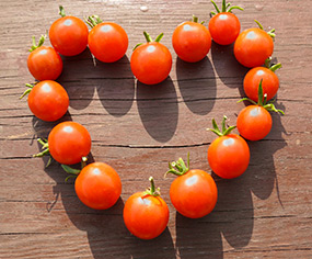 A heart made from cherry tomatoes